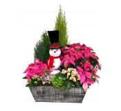 Cesta de flores de pascua con adorno