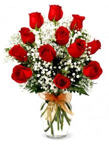 rosas  en Jarrón  de cristal con paniculata